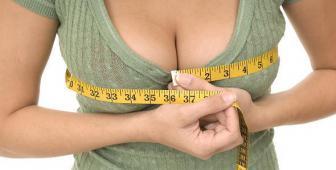 Как увеличить грудь женщине?